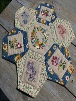 Daisy Table Topper Create your own daisy-shaped table topper with your favorite fabrics and embroidery designs, put a vase of wildflowers in the center, and transform your table!